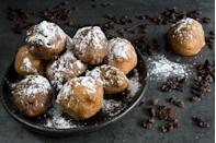 "<p>These Dutch treats are made from frying small balls of dough stuffed with raisins or currants in a pan of hot oil, hence the name <a href=""https://dutchreview.com/culture/food/dutch-oliebollen/"" rel=""nofollow noopener"" target=""_blank"" data-ylk=""slk:Oliebollen, or oil balls"" class=""link rapid-noclick-resp""><em>Oliebollen</em>, or oil balls</a>, the Dutch Review, a Netherlands magazine, reported. Known in the United States as Dutch Doughnuts, oliebollen are topped with powdered sugar and can be made with other ingredients, like cinnamon or apple pieces. The dessert is often eaten on New Year's Eve and washed down with champagne. </p>"