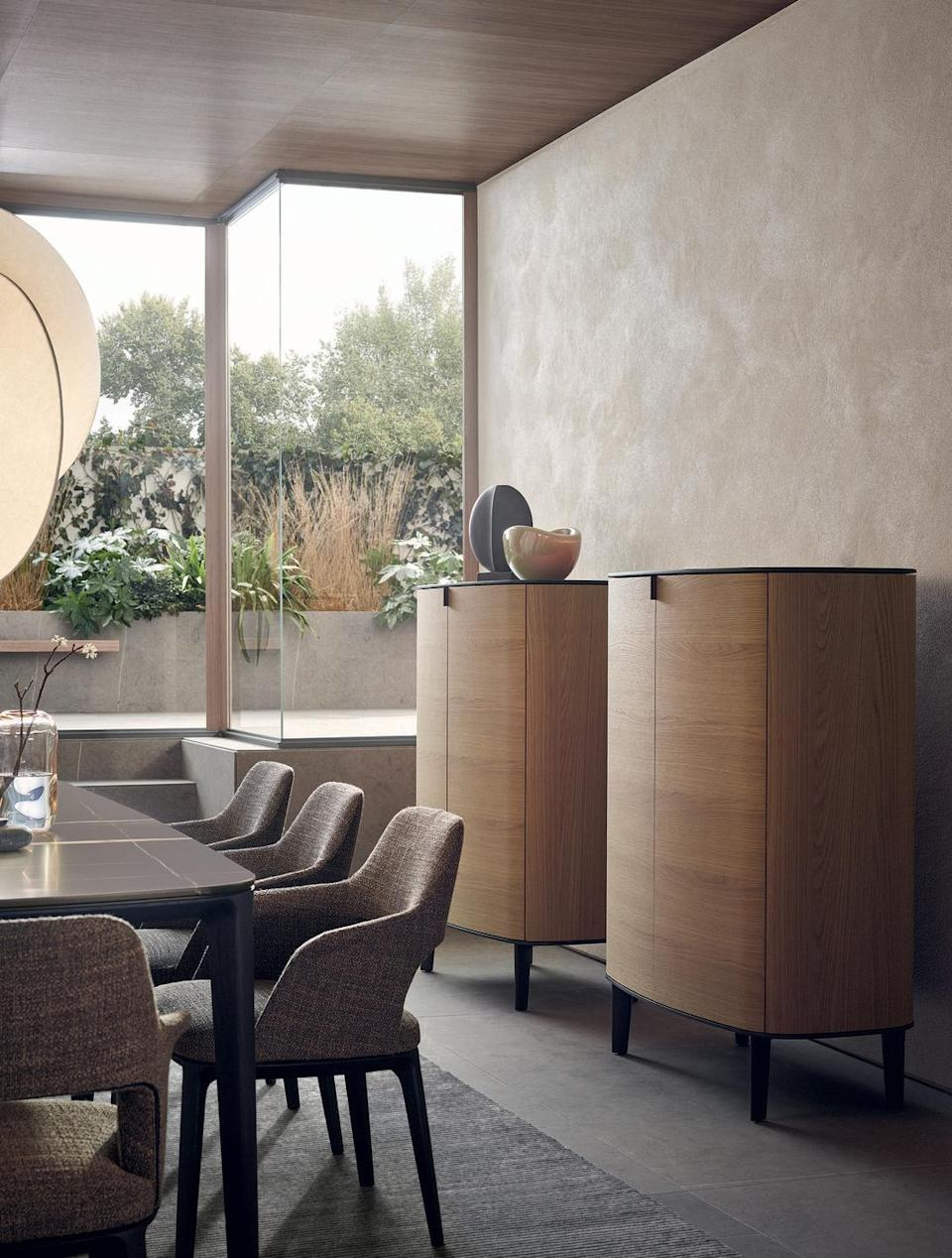 """<p>Symphony is a collection of sideboards where the simplicity of the lines is expressed through fine materials and accurate workmanship. The sideboards have an elliptical shape, enhanced by the wood finish.</p><p>Discover the Collection: <a href=""""https://www.poliform.it/en/products/symphony/"""" rel=""""nofollow noopener"""" target=""""_blank"""" data-ylk=""""slk:poliform.com"""" class=""""link rapid-noclick-resp"""">poliform.com </a></p>"""