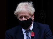 Britain's Prime Minister Boris Johnson wearing a face mask as he leaves Downing Street, in London