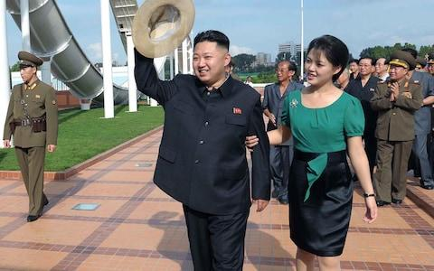 North Korean leader Kim Jong-un, accompanied by his wife Ri Sol-ju - Credit: AP