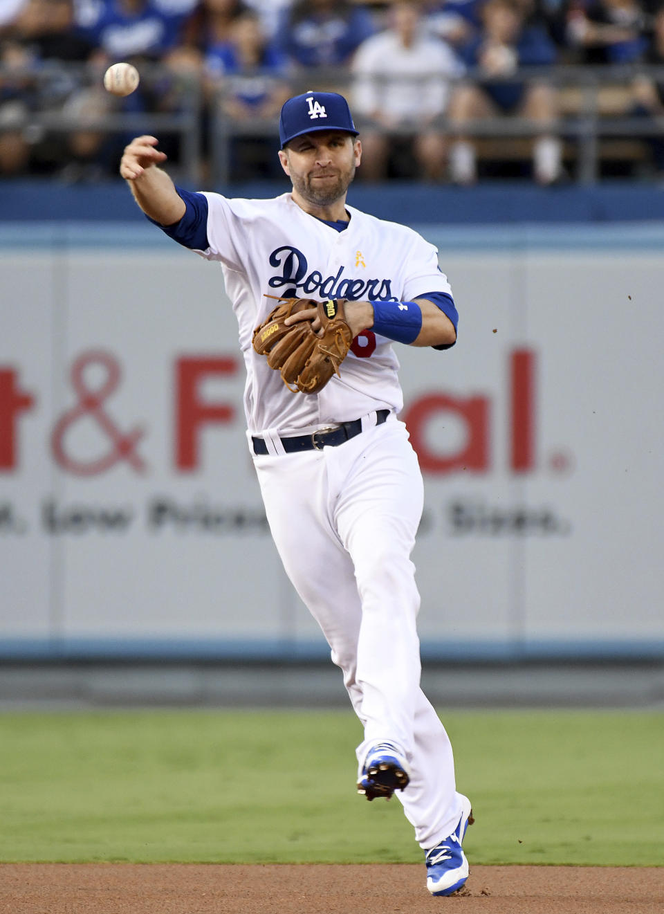 Los Angeles Dodgers second baseman Brian Dozier throws to first base after fielding a grounder by Arizona Diamondbacks' Paul Goldschmidt during the first inning of a baseball game, Saturday, Sept. 1, 2018, in Los Angeles. (AP Photo/Michael Owen Baker)
