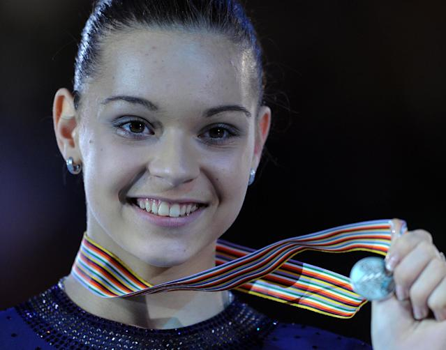 Russian Adelina Sotnikova shows her silver medal on the podium in the Dom Sportova sports hall in Zagreb on January 26, 2013 after the women's free skating event at the ISU European Figure Skating Championships. AFP PHOTO / ATTILA KISBENEDEKATTILA KISBENEDEK/AFP/Getty Images