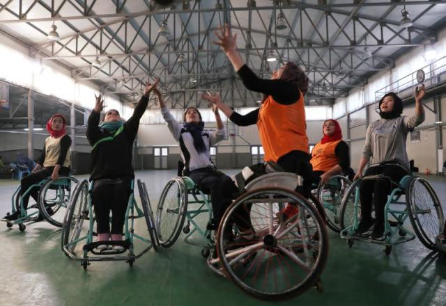 Disabled Afghan women play basketball at the Orthopaedic Center of the International Committee of the Red Cross in Kabul