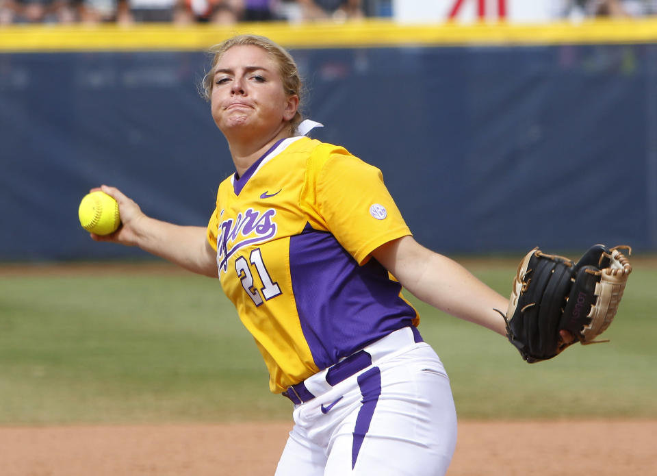 LSU's Carley Hoover pitches in the second inning during an NCAA Women's College World Series softball game against Michigan in Oklahoma City, Sunday, May 31, 2015. Michigan won 6-3 and moves on to the championship series. (AP Photo/Alonzo Adams)