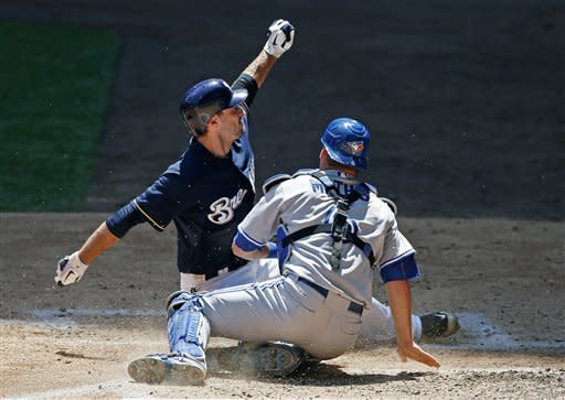 Milwaukee Brewers' Ryan Braun is tagged out by Toronto Blue Jays' Jeff Mathis while trying to steal home on a double steal during the third inning of a baseball game, Wednesday, June 20, 2012, in Milwaukee. (AP Photo/Tom Lynn)