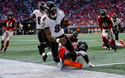 <span>Lamar Jackson runs in a touchdown in the Ravens' defeat of the Falcons</span> <span>Credit: Photo by Kevin C. Cox/Getty Images </span>