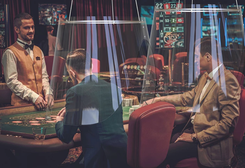 The Plex'Eat Shields in action at a casino's gambling table.