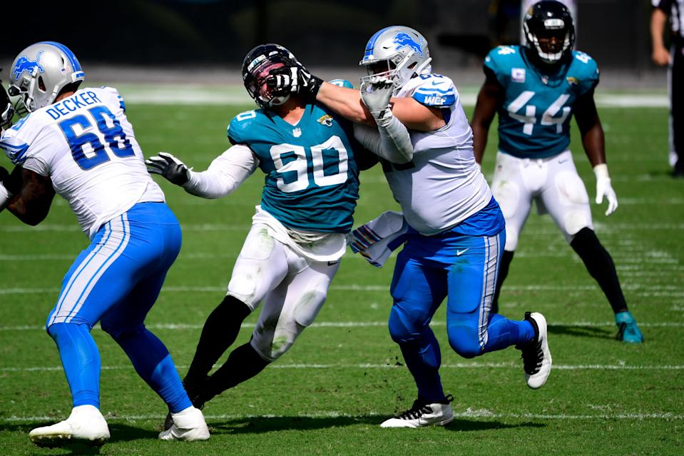Detroit Lions guard Joe Dahl is called for a penalty against Jacksonville Jaguars defensive tackle Taven Bryan during the first half at TIAA Bank Field, Oct. 18, 2020.