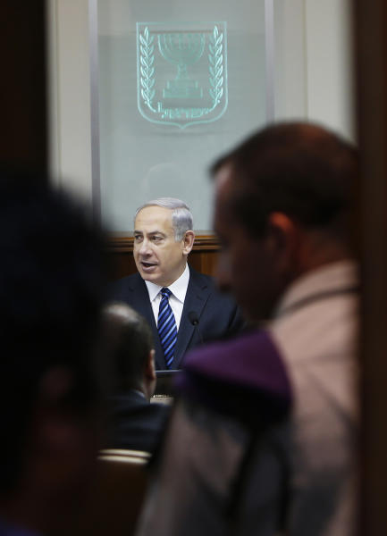 ALTERNATE CROP -- Israel's Prime Minister Benjamin Netanyahu, center, attends the weekly cabinet meeting in Jerusalem, Israel, May 19, 2013. Israeli Prime Minister Benjamin Netanyahu, whose air force struck suspected weapons shipments to Hezbollah from Damascus twice this month, warned at a weekly Cabinet meeting Sunday that Israel is prepared for any eventuality in Syria. (AP Photo/Ronen Zvulun)