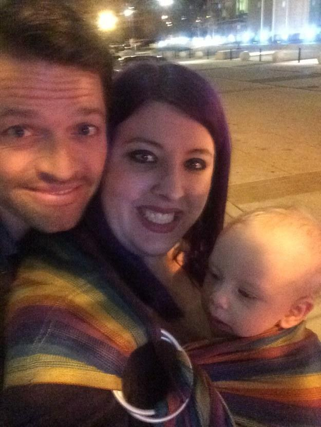 A fan with her baby posing for a selfie with Misha Collins