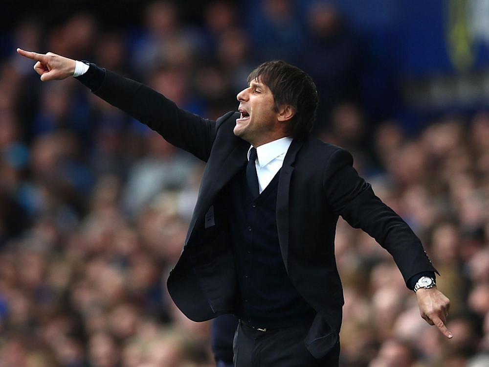 Antonio Conte can almost feel that Premier League trophy in his grip: Getty