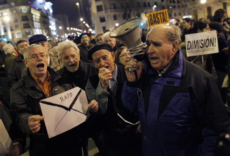"Protestors shouts slogans as they hold an envelope during a demonstration against corruption, in Madrid, Spain, Thursday, Jan. 31, 2013. Spain's governing Popular Party insists its financial accounts are totally legal and denies a newspaper report of regular under-the-table payments to leading members, including current Prime Minister Mariano Rajoy. The scandal first broke when after the National Court reported that former party treasurer Luis Barcenas amassed an unexplained euro 22 million ($30 million) in a Swiss bank account several years ago. In a statement Thursday Jan. 31, 2013, the party denied the existence of ""hidden accounts"" or ""the systematic payment to certain people of money other than their monthly wages. (AP Photo/Andres Kudacki)"