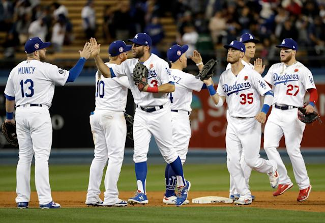 The Los Angeles Dodgers celebrate after a 9-5 win over the New York Mets in a baseball game, Monday, May 27, 2019, in Los Angeles. (AP Photo/Marcio Jose Sanchez)