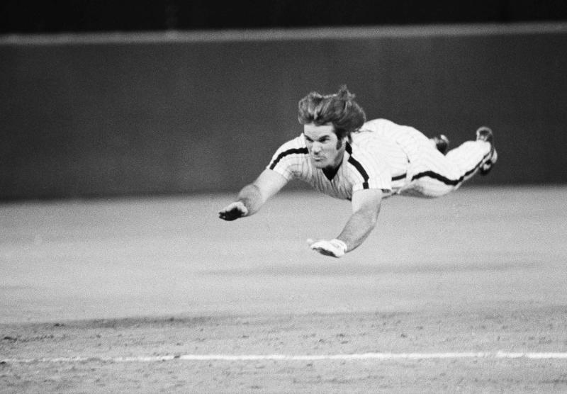 FILE - In this June 3, 1981 file photo, Philadelphia Phillies' Pete Rose slides to third base during a baseball game against the New York Mets in Philadelphia. Rose says cheating on the field is bad for the game, and the one thing he never did with his bets is change the outcome of a game.  (AP Photo/Rusty Kennedy, File)