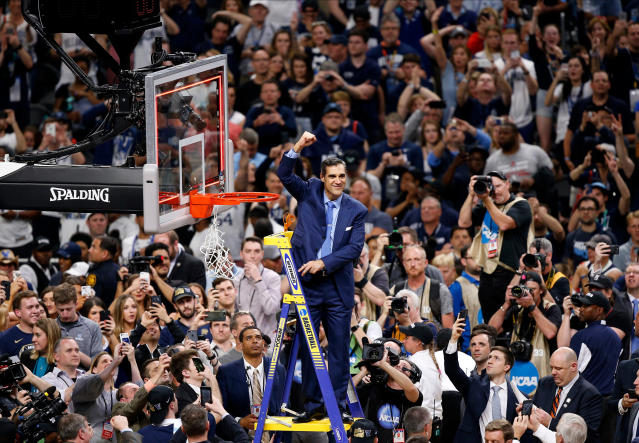 Villanova head coach Jay Wright reacts after cutting down the net after beating Michigan 79-62 in the championship game of the Final Four NCAA college basketball tournament, Monday, April 2, 2018, in San Antonio. (AP Photo/Brynn Anderson)