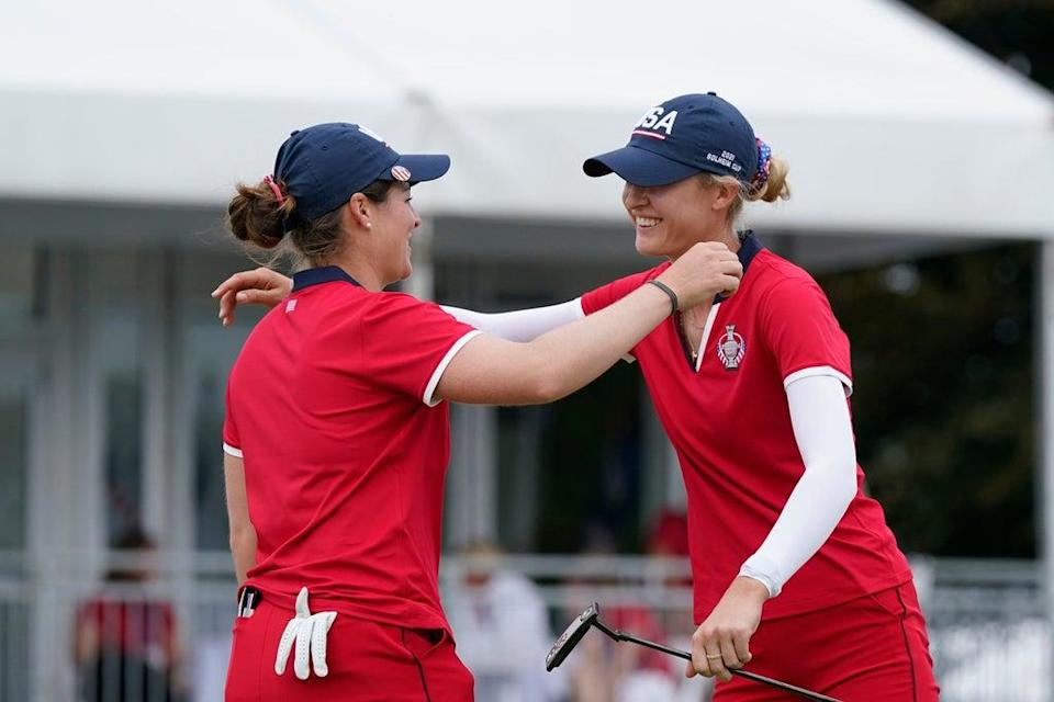 Ally Ewing, left, and Nelly Korda celebrate their win on the 18th green (Carlos Osorio/AP) (AP)