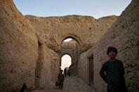 Among the ancient towers, doors and windows have been added and crumbling walls coated with a clay and straw mixture to strengthen them and plug gaps