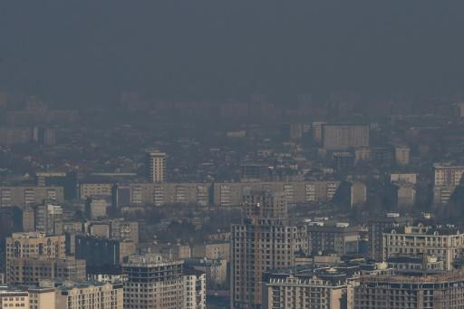 A heavy cloud of smog often blots out the view of snow-capped mountains in the Kyrgyz capital Bishkek