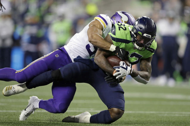 Seattle Seahawks' Chris Carson (32) is brought down by Minnesota Vikings' Eric Wilson on a 26-yard carry during the second half of an NFL football game, Monday, Dec. 2, 2019, in Seattle. (AP Photo/John Froschauer)