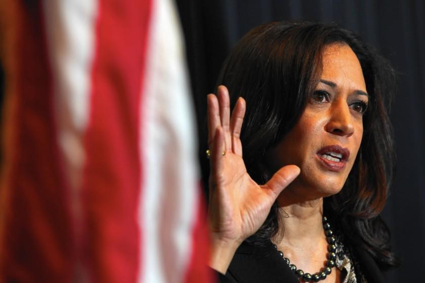 California Atty. Gen. Kamala Harris, whose aide Brandon Kiel is accused of forming a fictitious police force with two people, has received regular briefings on the case since his arrest.