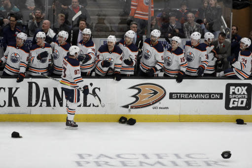 Edmonton Oilers center Connor McDavid is congratulated after his third goal against the Anaheim Ducks, during the third period of an NHL hockey game in Anaheim, Calif., Sunday, Nov. 10, 2019. (AP Photo/Chris Carlson)