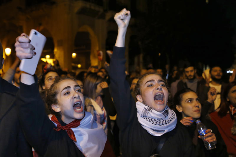 Protesters chant slogans during ongoing protests against the Lebanese political class, in downtown Beirut, Lebanon, Sunday, Dec. 22, 2019. Lebanon's new prime minister held consultations Saturday with parliamentary blocs in which they discussed the shape of the future government. The next administration will have to steer the country out of its worst economic and financial crisis in decades. (AP Photo/Bilal Hussein)