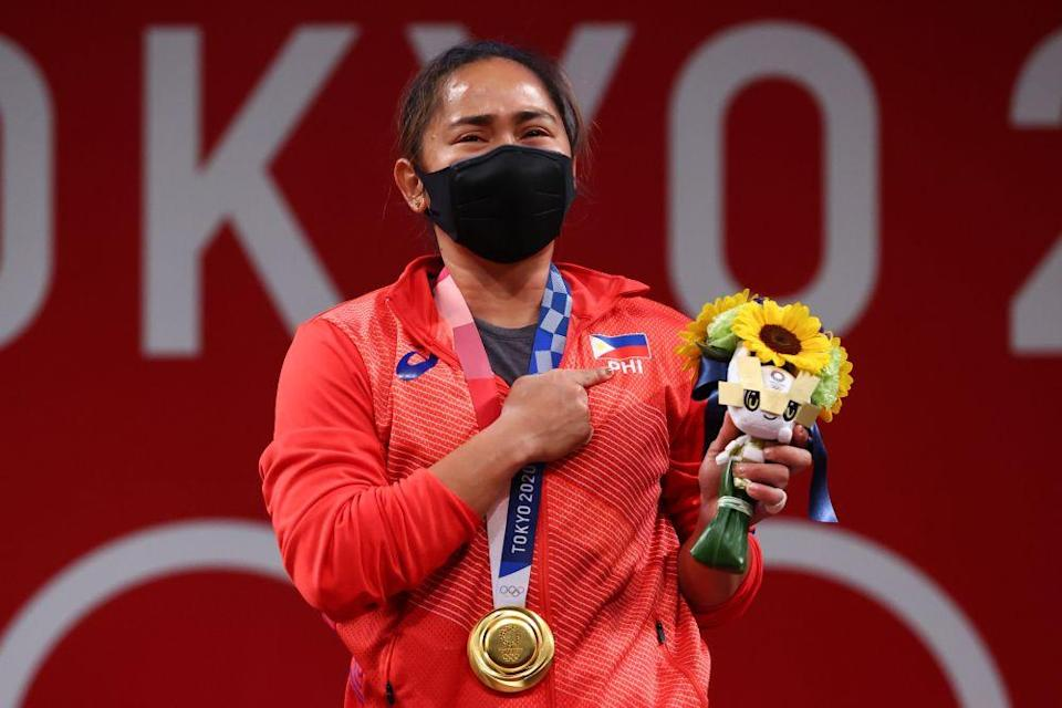 Gold medallist Hidilyn Diaz of the Philippines reacts to her victory at the Tokyo International Forum July 26, 2021. — Bernama pic