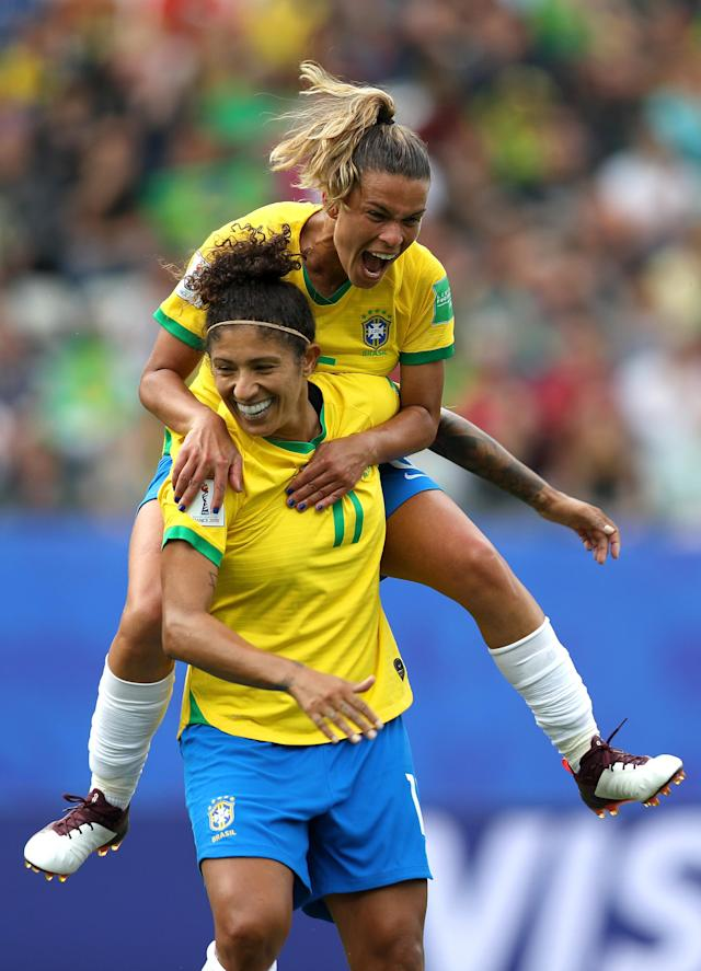 Cristiane of Brazil celebrates after scoring her team's third goal with teammate Tamires during the 2019 FIFA Women's World Cup France group C match between Brazil and Jamaica at Stade des Alpes on June 09, 2019 in Grenoble, France. (Photo by Naomi Baker - FIFA/FIFA via Getty Images)