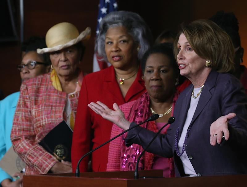 House Minority Leader Nancy Pelosi (D-Calif.) speaks while flanked by members of the Congressional Black Caucus during a news conference on Capitol Hill on April 22, 2015. Pelosi urged the Senate to immediately confirm Loretta Lynch's nomination as attorney general.