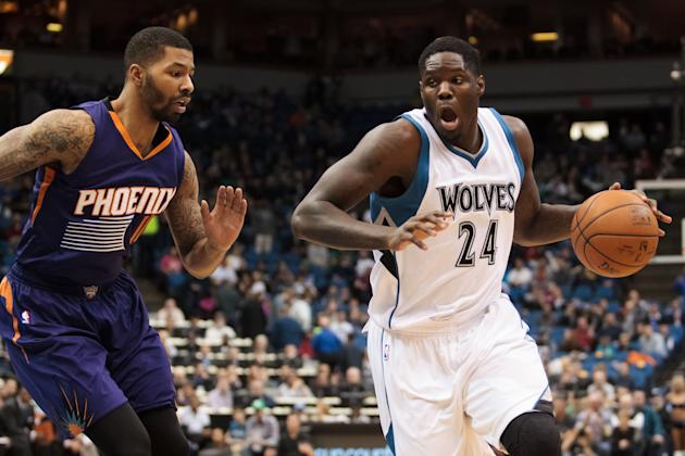 Feb 20, 2015; Minneapolis, MN, USA; Minnesota Timberwolves forward Anthony Bennett (24) dribbles in the first quarter against the Phoenix Suns forward Markieff Morris (11) at Target Center. (Brad Rempel-USA TODAY Sports)