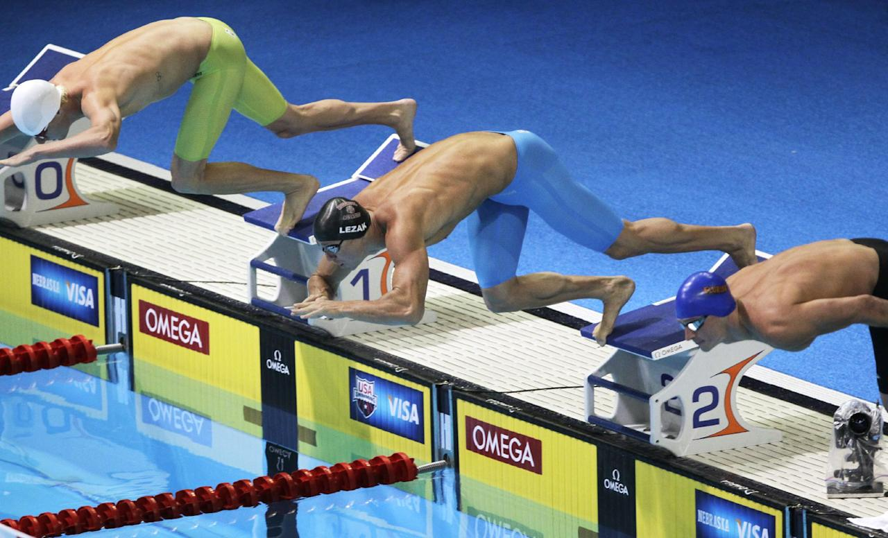 David Walters, from left, Jason Lezak and Ryan Lochte dive at the start of a men's 100-meter freestyle semifinal at the U.S. Olympic swimming trials, Thursday, June 28, 2012, in Omaha, Neb. (AP Photo/Nati Harnik)