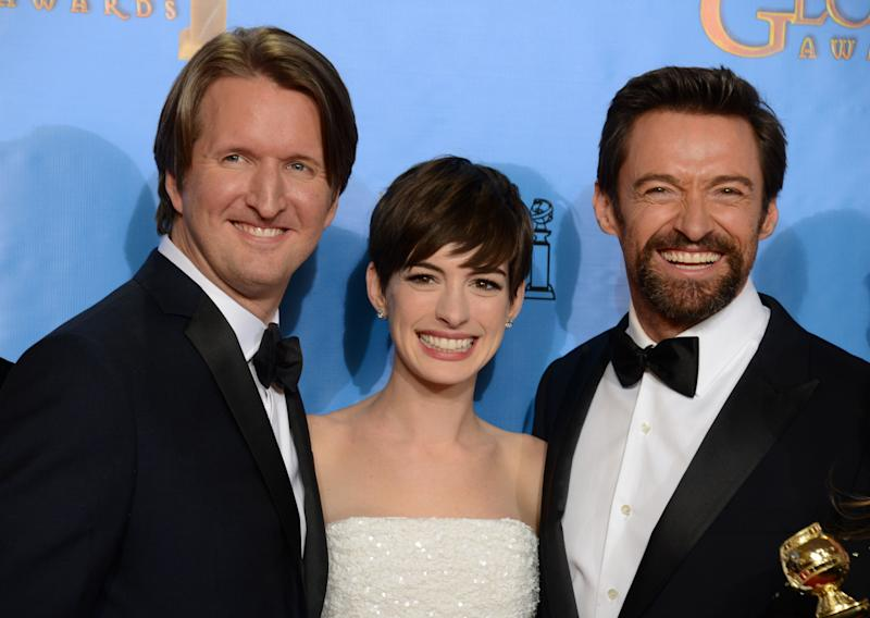 "Director Tom Hooper, left, actress Anne Hathaway, center, and actor Hugh Jackman pose with the award for best motion picture comedy or musical for ""Les Miserables"" backstage at the 70th Annual Golden Globe Awards at the Beverly Hilton Hotel on Sunday Jan. 13, 2013, in Beverly Hills, Calif. (Photo by Jordan Strauss/Invision/AP)"