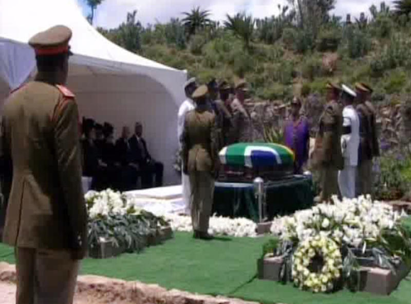 This frame grab from SABC shows pallbearers standing by the casket of former South African president Nelson Mandela's during his funeral service Sunday, Dec. 15, 2013, in Qunu, South Africa. (AP Photo/SABC, Pool)