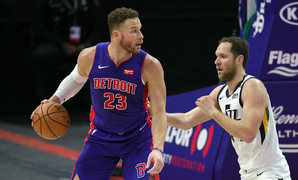 Blake Griffin #23 of the Detroit Pistons looks to shoot the ball as Joe Ingles #2 of the Utah Jazz defends during the fourth quarter of the game against the Detroit Pistons at Little Caesars Arena.