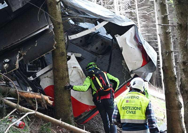 Carabinieri and Soccorso Alpino forces inspect the site where the Stresa-Alpino–Mottarone cable car crashed to the ground after a cable snapped on 23 May 2021, in Mottarone Stresa, northern Italy.