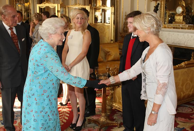 Helen Mirren, pictured with Queen Elizabeth in 2011, says Meghan Markle made the right decision by stepping back from the royal family. (Photo: Dominic Lipinski - WPA Pool/Getty Images)