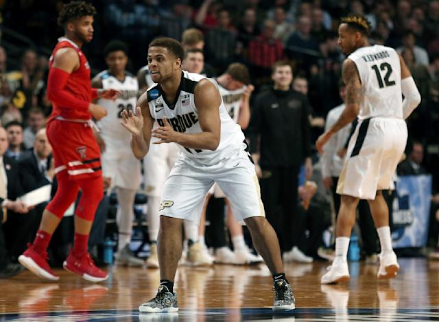 Purdue's P.J. Thompson encourages his teammates during the first half of an NCAA men's college basketball tournament regional semifinal against Texas Tech, Friday, March 23, 2018, in Boston. (AP Photo/Mary Schwalm)