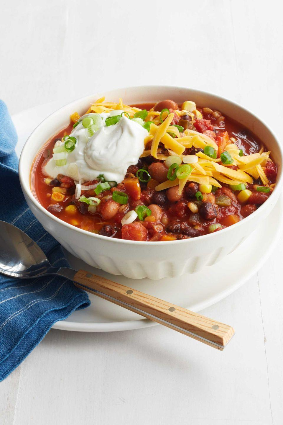 """<p>Winter calls for chili! Chili is best when it simmers for a couple of hours so all of the tasty flavors in this vegetarian recipe can blend together for a comforting result. </p><p><a href=""""https://www.womansday.com/food-recipes/food-drinks/recipes/a52065/vegetarian-chili-with-wheat-berries-beans-and-corn/"""" rel=""""nofollow noopener"""" target=""""_blank"""" data-ylk=""""slk:Get the Vegetarian Chili with Wheat Berries, Beans, and Corn recipe."""" class=""""link rapid-noclick-resp""""><em>Get the Vegetarian Chili with Wheat Berries, Beans, and Corn recipe.</em></a></p>"""