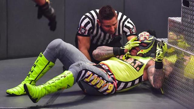 """The ref checks on Rey Mysterio, who hopes to keep his eye in place. <span class=""""copyright"""">(WWE)</span>"""