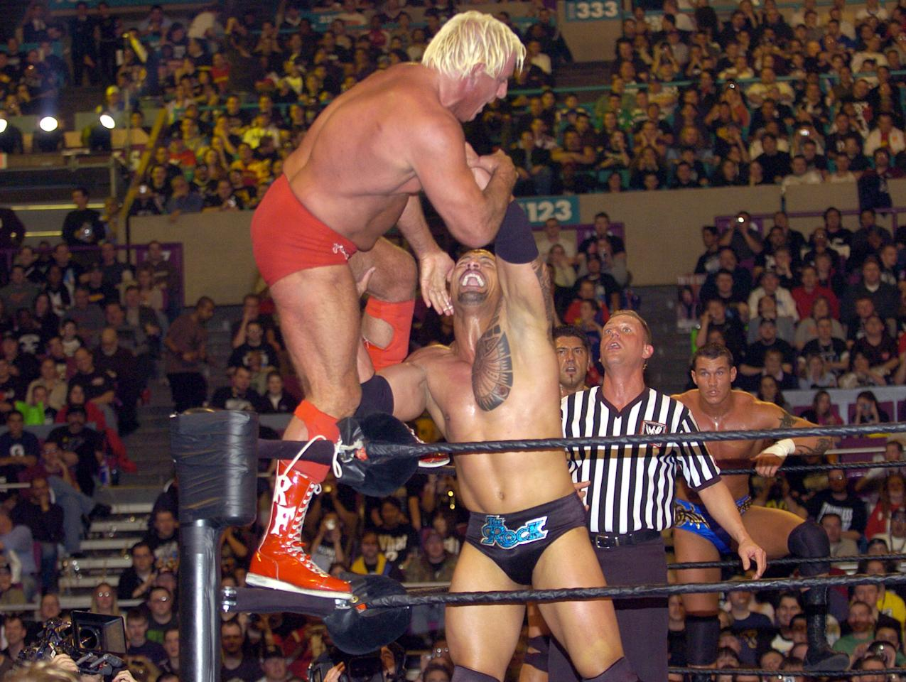 <p>Nature Boy Ric Flair (left) and The Rock during Wrestle Mania XX at Madison Square Garden in New York City, New York, United States. (Photo by KMazur/WireImage) </p>