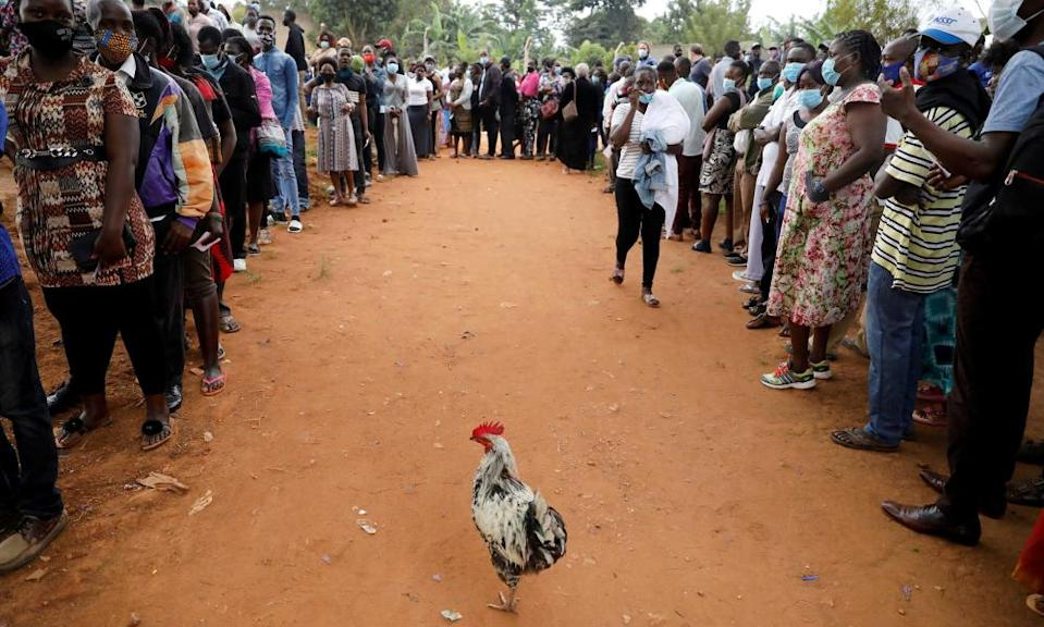 Voters queue outside a voting centre in Kampala.