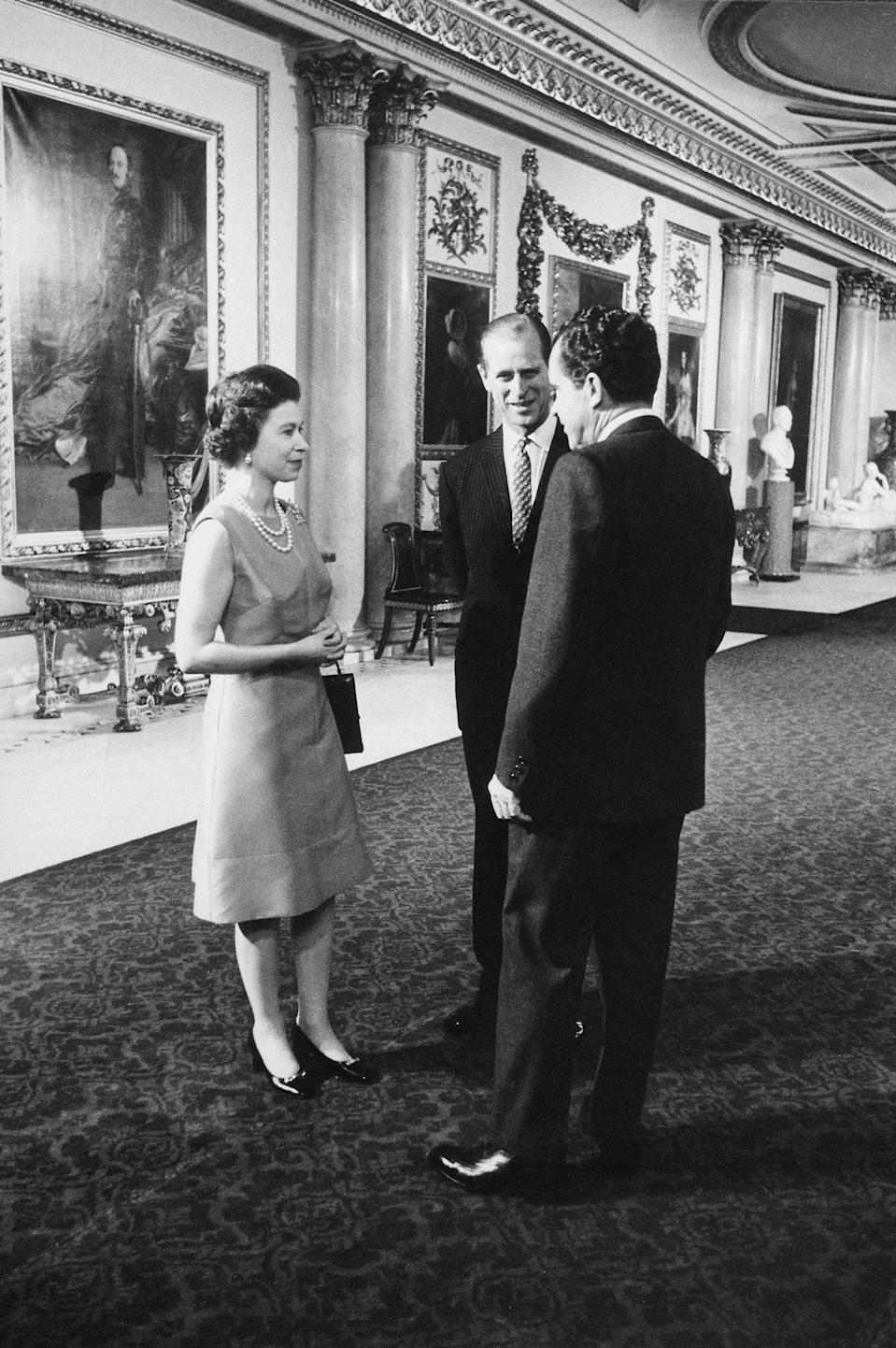 President Nixon chats with Queen Elizabeth II and Prince Phillip at Buckingham Palace, 25 February 1969Everett/Shutterstock