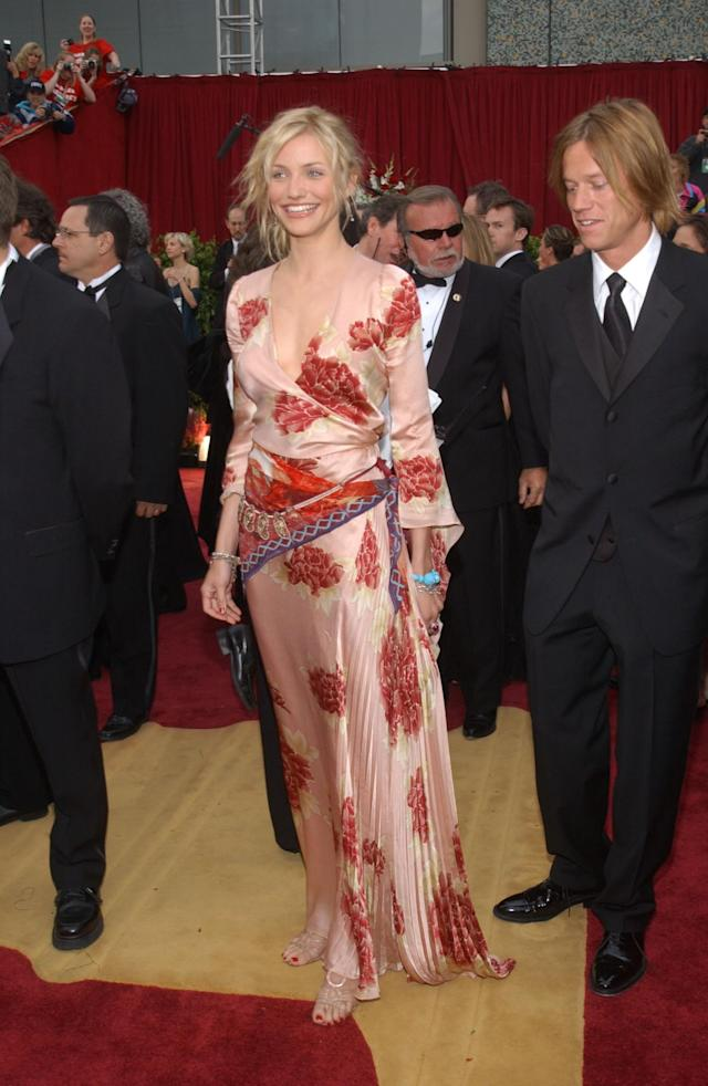 <p>Cameron belted her floral-print 2002 Ungaro gown and added antique Indian jewelry to create a red carpet look that suited her boho vibe. (Photo: Vince Bucci/Getty Images) </p>