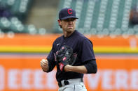 Cleveland Indians starting pitcher Shane Bieber looks towards first during the third inning of a baseball game against the Detroit Tigers, Thursday, April 1, 2021, in Detroit. (AP Photo/Carlos Osorio)