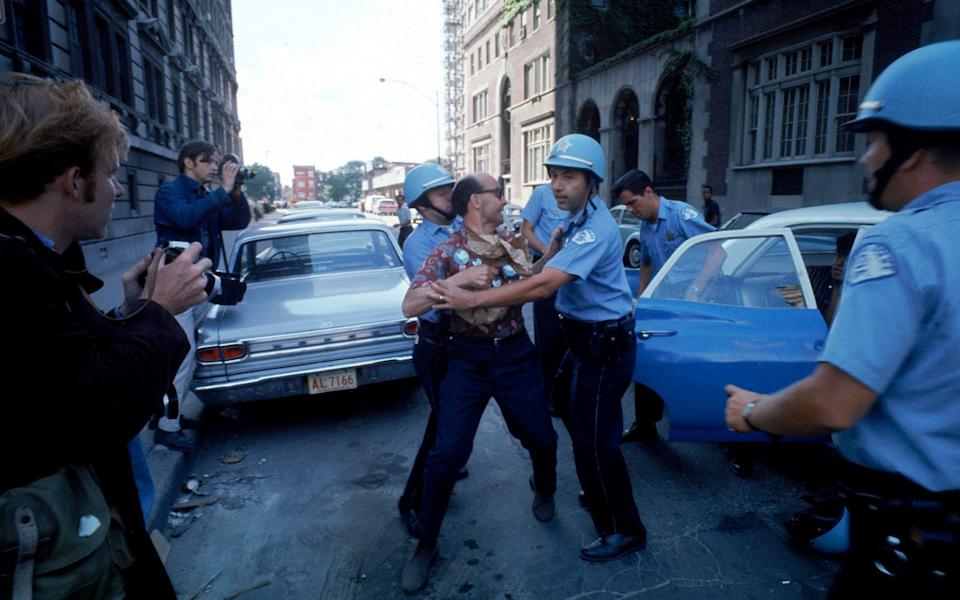 Police restrain a protester during the 1968 Democratic National Convention - Julian Wasser