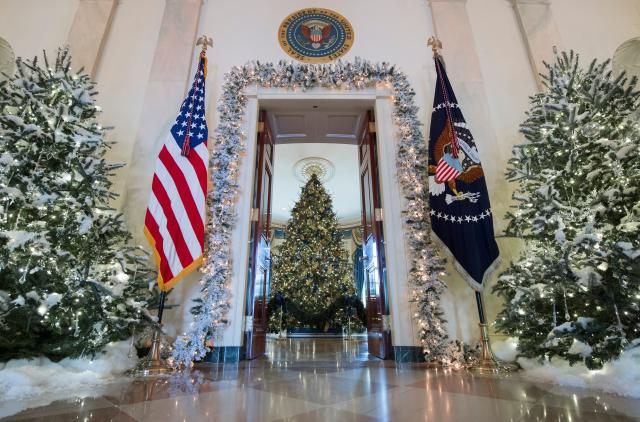 <p>Christmas trees are seen during a preview of holiday decorations in the Grand Foyer of the White House in Washington, D.C., Nov.27, 2017. (Photo: Saul Loeb/AFP/Getty Images) </p>