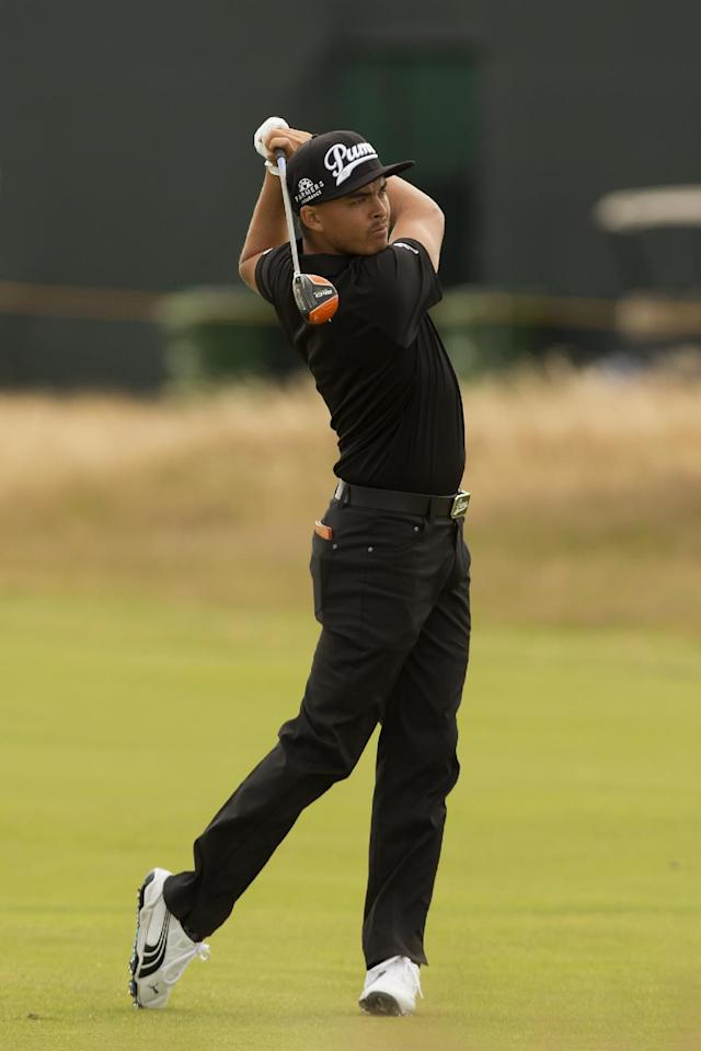 Rickie Fowler of the US plays a shot from the 6th fairway during a practice round at the Royal Liverpool Golf Club prior to the start of the British Open Golf Championship, in Hoylake, England, Monday, July 14, 2014. The 2014 Open Championship starts on Thursday, July 17. (AP Photo/Jon Super)