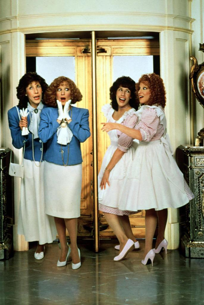 <p>Two sets of twins is always better than one, especially when they're played by Tomlin and Midler — who portray a pair of identical sisters who get mismatched at birth in this 1988 comedy. <i>(Photo: Everett Collection)</i></p>