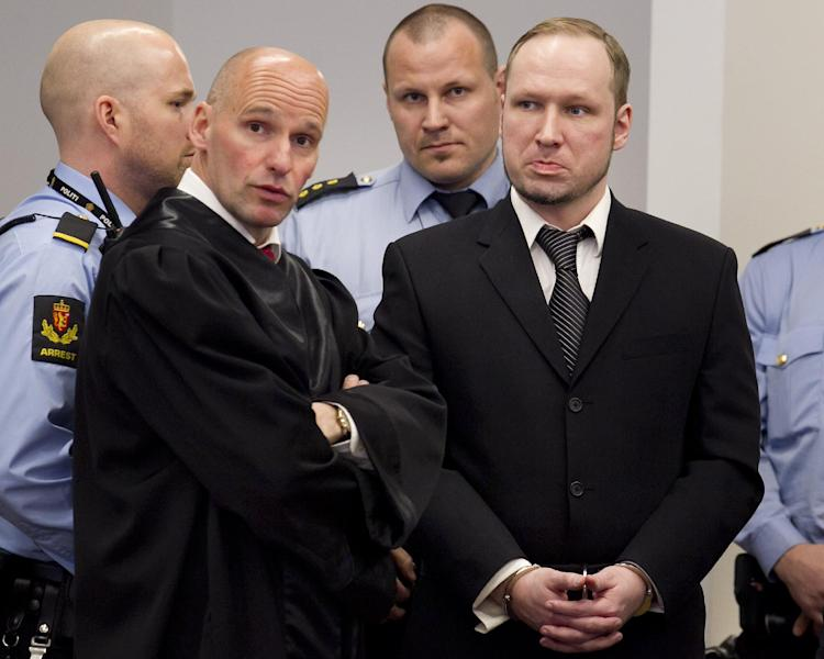 "Defendant Anders Behring Breivik with his lawyer Geir Lippestad , left, during the third day of proceedings in courtroom 250 in the courthouse in Oslo Wednesday April 18, 2012. Confessed mass killer Breivik on Wednesday called Norway's prison terms ""pathetic"" and said the death penalty or an acquittal were the ""only logical outcomes"" for his massacre of 77 people. (AP Photo/ Heiko Junge, Pool)"