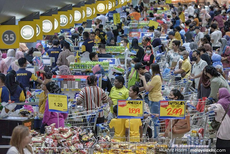 Panic buying has been an occasional feature. Here, people line up at a supermarket in Subang Jaya as they shop for essentials after the government announced the movement control order (MCO) on Mar 17, 2020.<p><br></p>